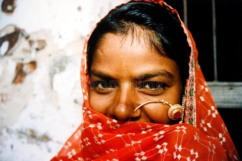 Rajasthani woman - India. JAIPUR - AUG 25: Rajasthani woman outside here home on August 25 2004 in Jaipur Rajasthan, India.In India, Dalit women experience high royalty free stock image