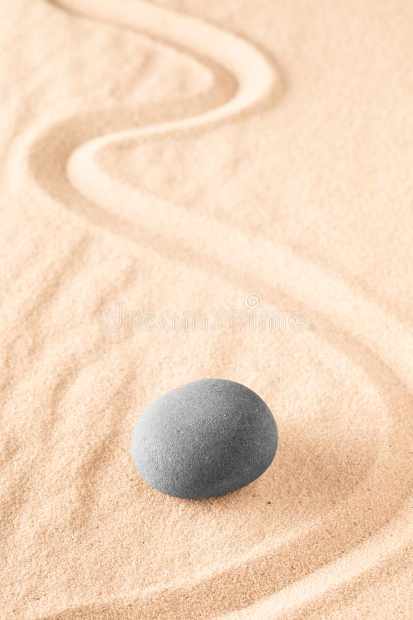 Raked sand and spa wellness healing stones. Zen buddhism meditation stone for concentration and relaxation through minimalism and purity. Spiritual background royalty free stock photography