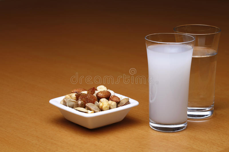 Raki and water with dried fruit stock photos