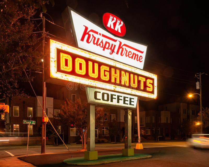 Raleigh, NC / United States - Oct. 12, 2019: Landcape three-quarter image of the iconic neon Krispy Kreme Sign at night. Horizontal view of the famous neon sigh stock photography