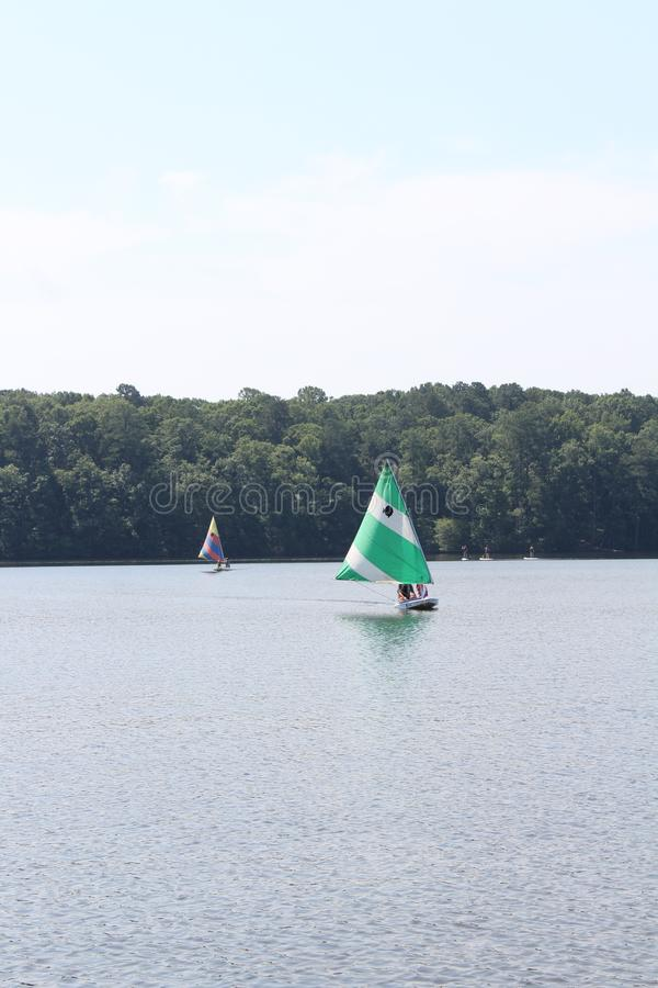 Sail boats in the lake stock images