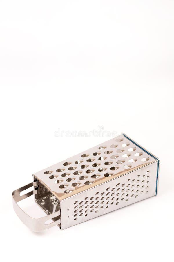 Rallador a estrenar del metal en el fondo blanco con el espacio de la copia fotografía de archivo libre de regalías