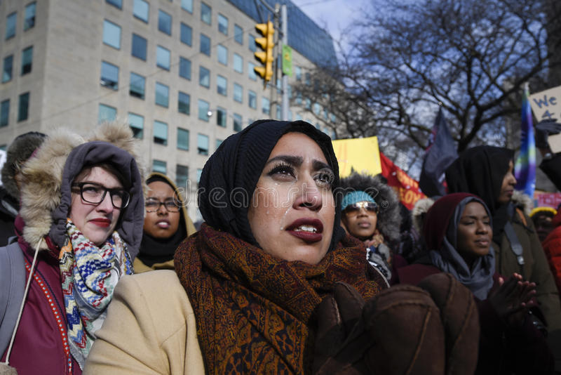 Rally against Donald Trump`s Muslim ban in Toronto. stock photo