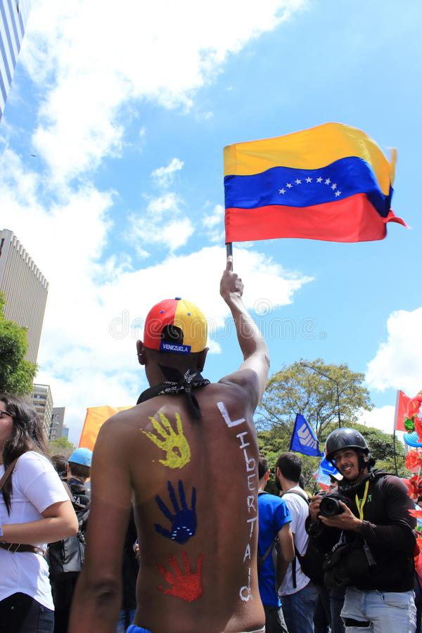 A rally against Maduro dictatorial regime in Caracas Venezuela shows Guaido supporters volunteering for humanitarian aid. Caracas/Venezuela February 23, 2019 royalty free stock photography