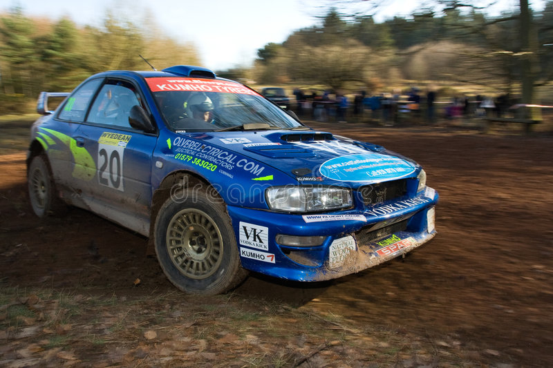 Rally Car. Wyedean Rally in the Forest of Dean, Gloucestershire. Subaru Impreza on Stage 6. Shot taken on hairpin bend with motion blurred background stock photo