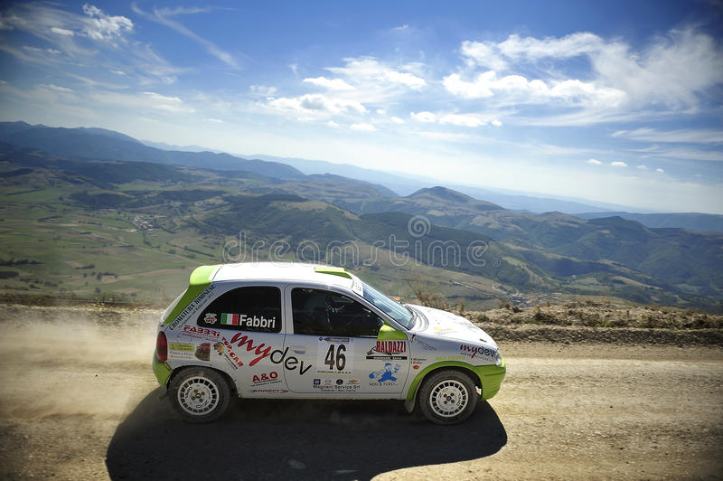 Rally Car on race. A Opel Corsa rally car driven by Denis Fabbri during the 2th stage of Nido dell'Aquila in Nocera Umbra (Italy) a competition race of hill royalty free stock image