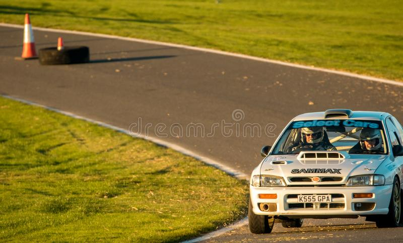 Rally Car Race. 18th November 2018 - Cadwell Park, Lincolnshire, United Kingdom. Competitors race around a tarmac racetrack in their modified and powered rally royalty free stock images