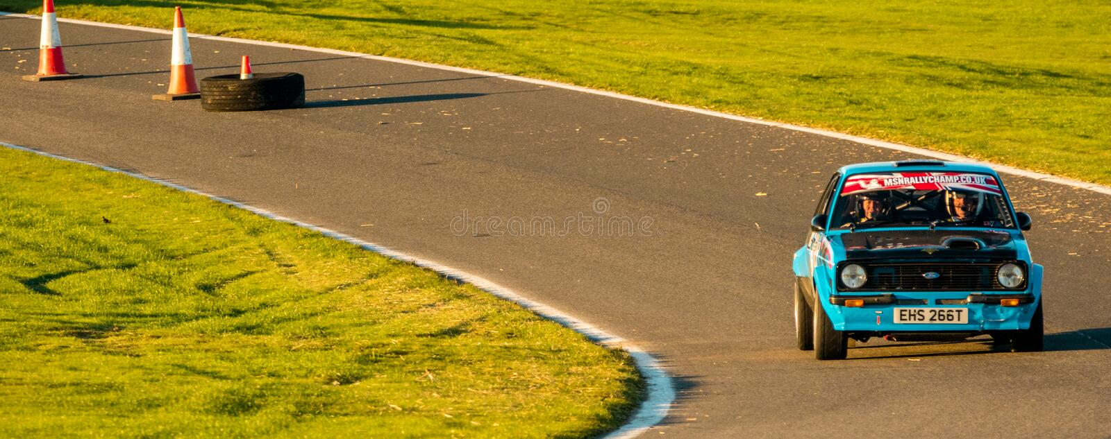 Rally Car Race. 18th November 2018 - Cadwell Park, Lincolnshire, United Kingdom. Competitors race around a tarmac racetrack in their modified and powered rally royalty free stock photos