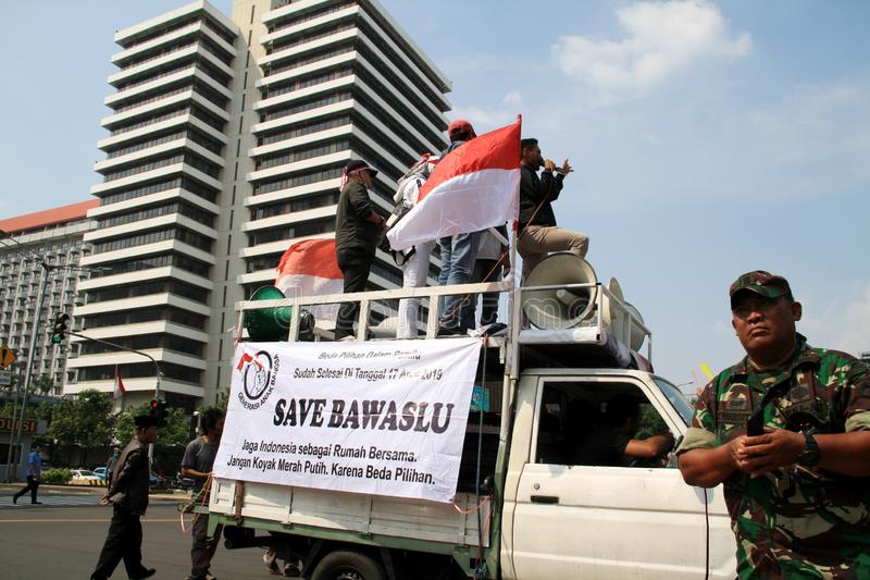 Rally in Jakarta. Jakarta, Indonesia - May 21, 2019: Supporters of KPU`s decision gave speeches at the headquarters of the Election Supervisory Agency Bawaslu on stock photos