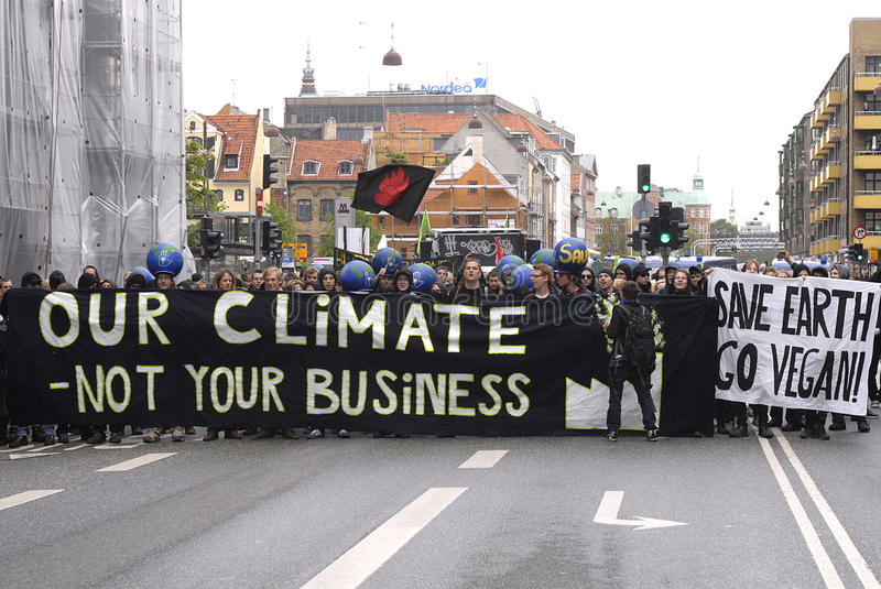 RALLY OUR CLIMATE IS NOT YOUR BUSINESS royalty free stock photos