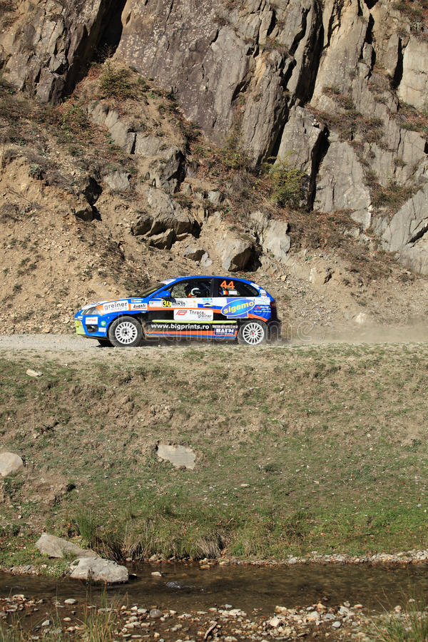 Rally racing taking place along a rivulet stock photos