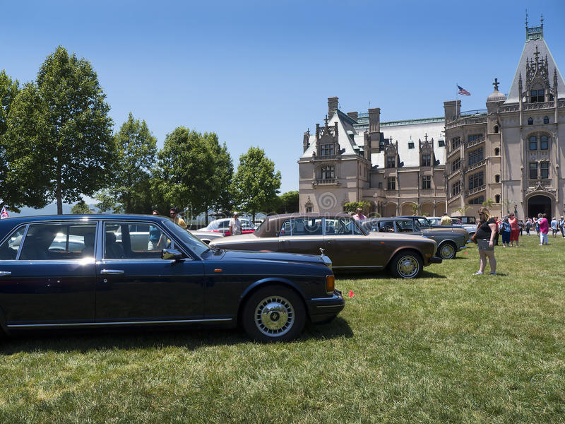 Rally of Rolls Royce and other luxury automobiles in Asheville North Carolina USA. Biltmore Estate is a large private estate and tourist attraction in Asheville royalty free stock images