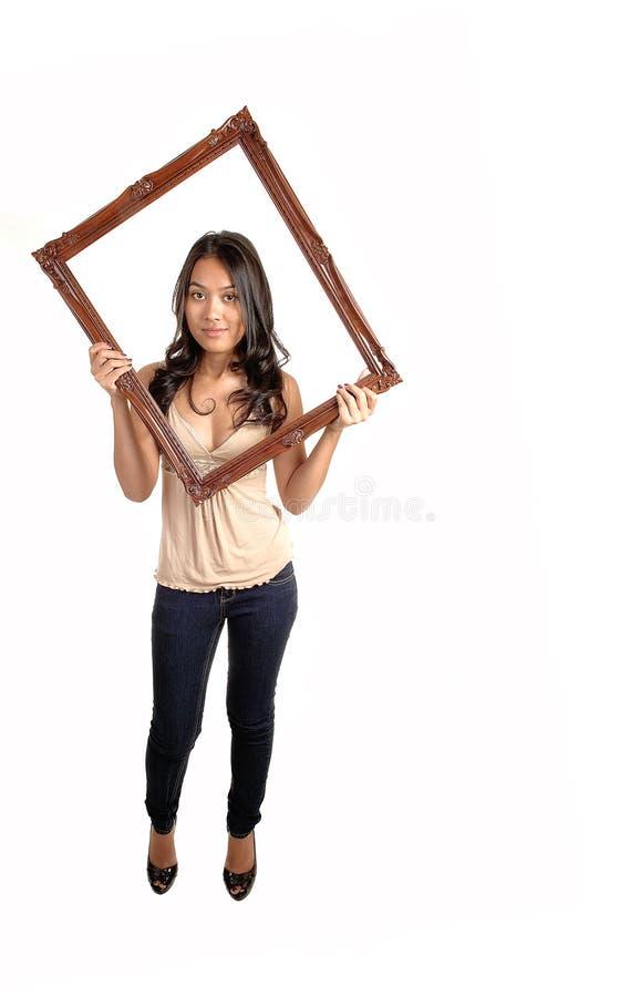 Ram för flickaholdingbild. royaltyfri foto