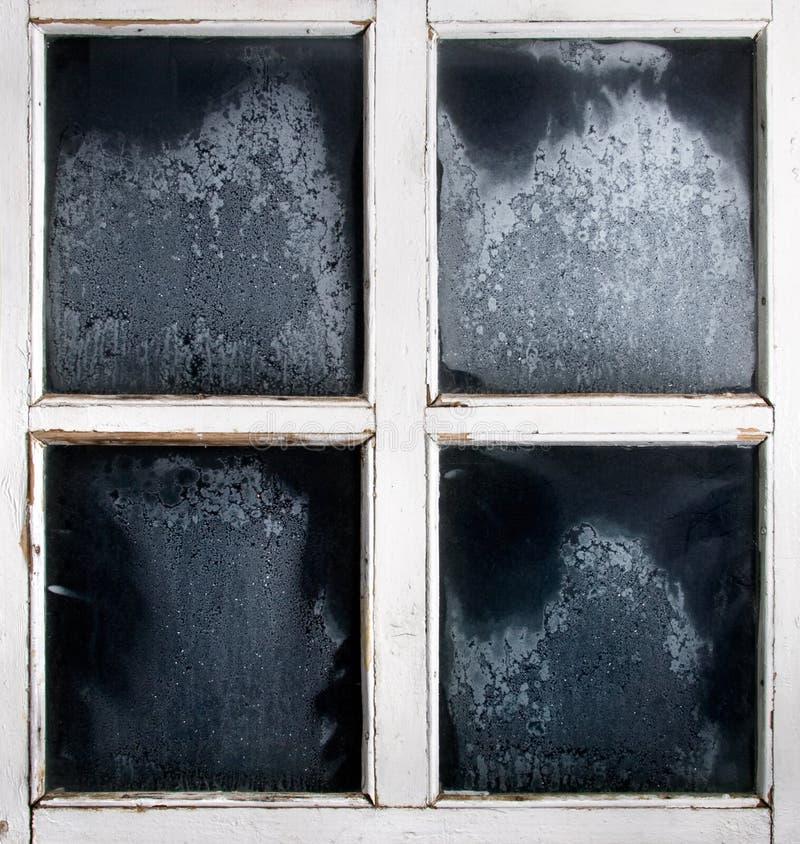 ram fryst glass fönster arkivfoto