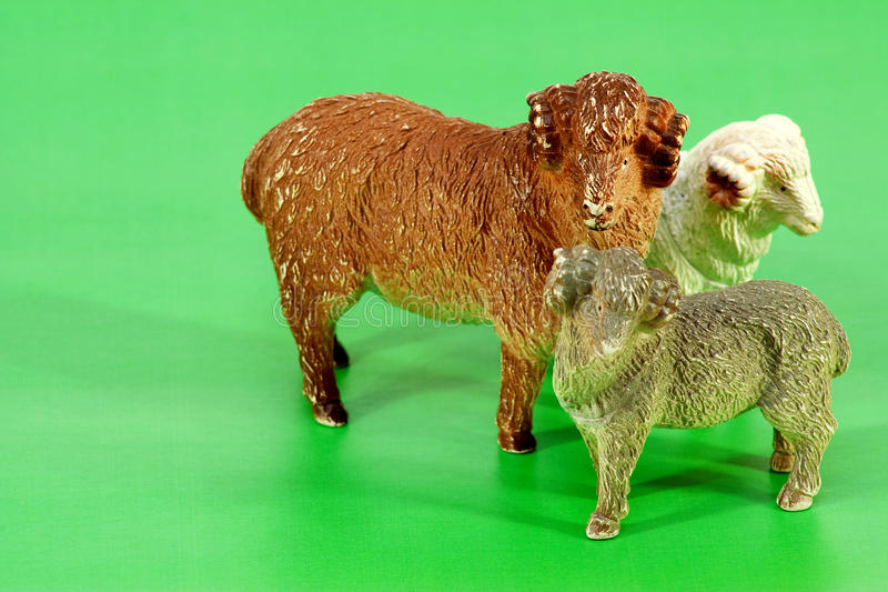 Ram-toy. Toy rams standing on an artificial green meadow stock photos