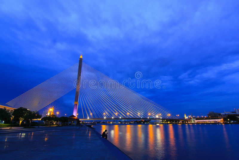 Rama8 bridge. Night rama8 bridge river construction thailand twilight bangkok light line rode asia street stock image