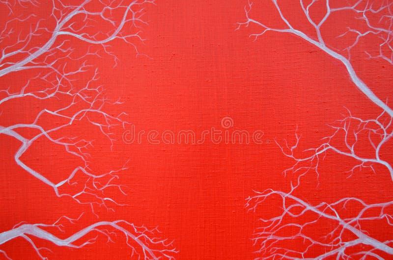 Rama de árbol en un fondo rojo imágenes de archivo libres de regalías