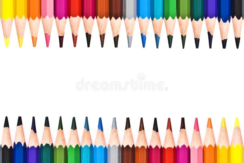 Rama kolorowi drewniani ołówki zdjęcia royalty free