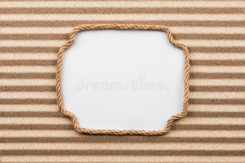 Rama robić arkana z białym tłem na piasku obrazy stock