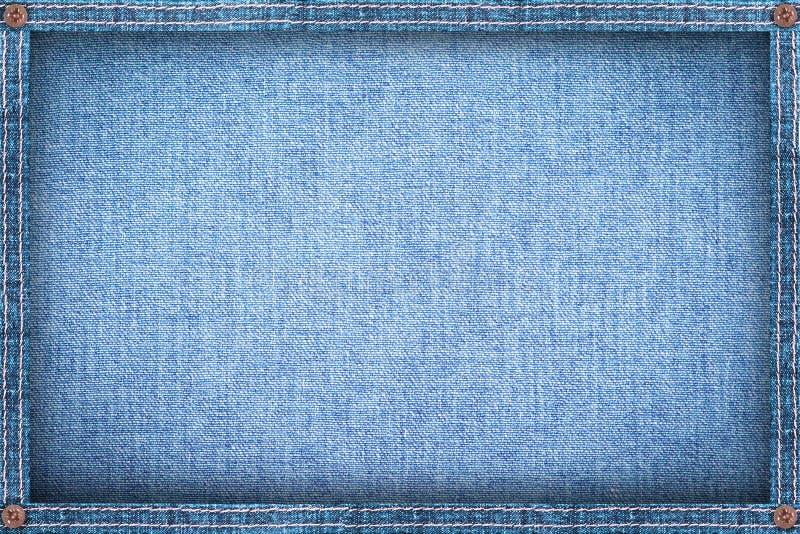 Rama robić od drelichu, niebiescy dżinsy tło zdjęcie royalty free