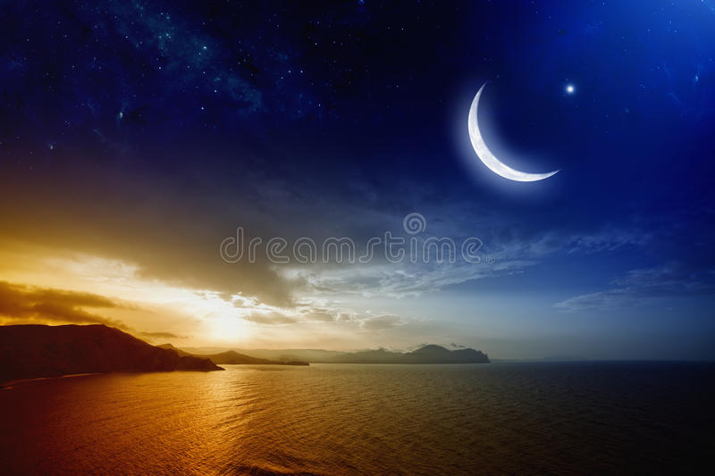 Ramadan background. With moon and stars, holy month, beautiful red sunset over sea. Elements of this image furnished by NASA
