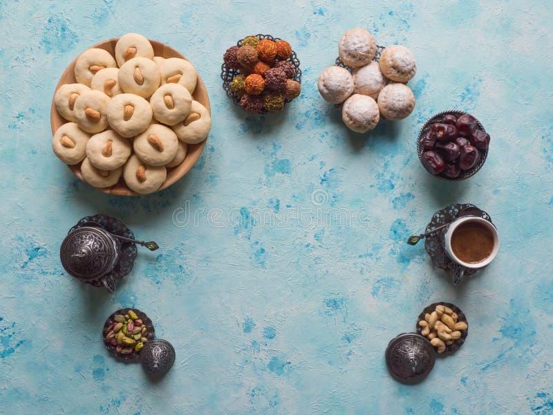 Ramadan food background. Eid eats. Ghorayeba sweets. Cookies of El Fitr Islamic Feast.  royalty free stock photo