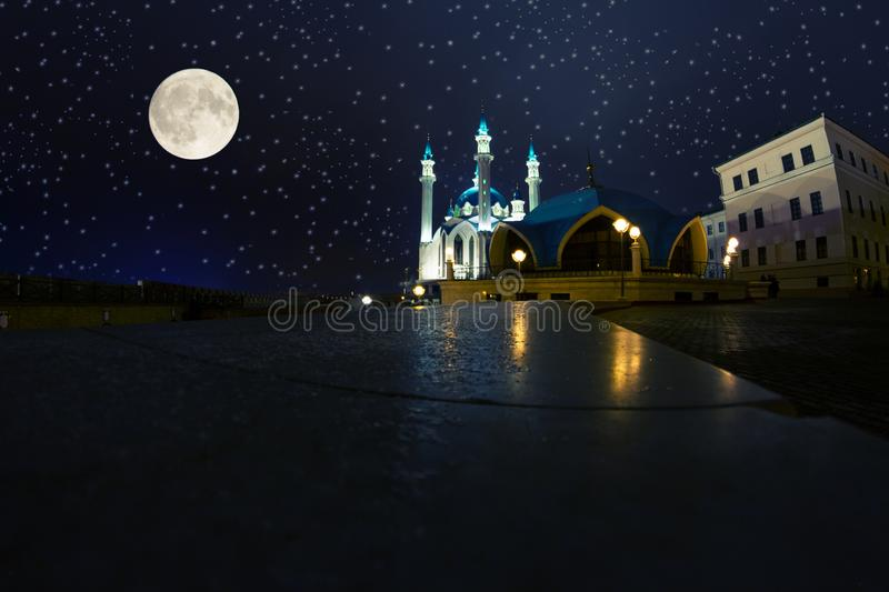 A ramadan moon and the mosque stock photography