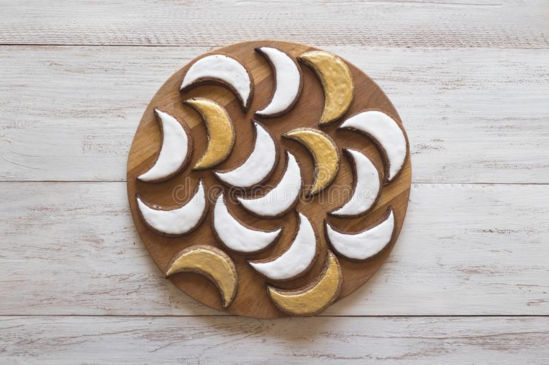 Ramadan sweets. Cookies golden crescent Ramadan. Ramadan sweets. Cookies golden crescent Ramadan on a white wooden table. Top view stock images