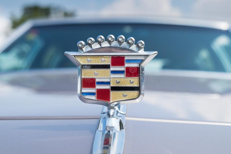 Vintage Cadillac hood ornament on white gray background. RAMAT-GAN, ISRAEL - OCTOBER 6, 2017: Vintage Cadillac hood ornament on white gray background stock image