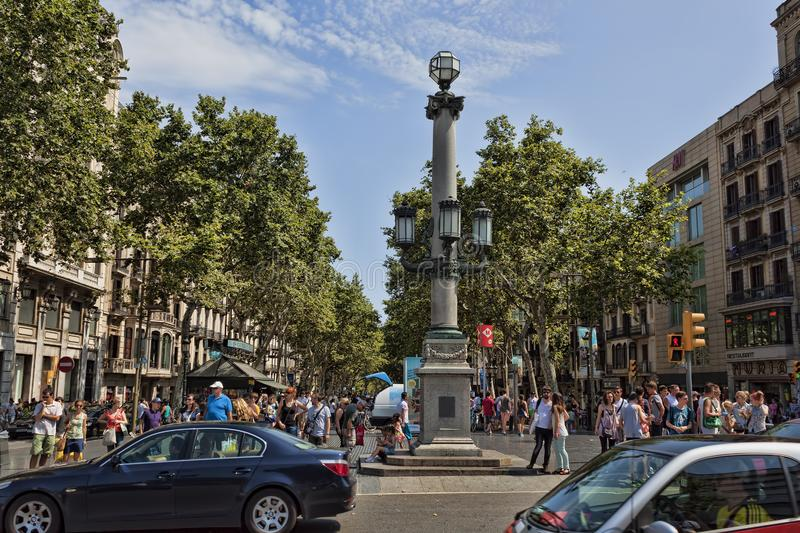 Rambla - a pedestrian street in the center of Barcelona. There is always a lot of tourists. BARCELONA, SPAIN - JULY 13, 2013: Rambla - a pedestrian street in the royalty free stock photo