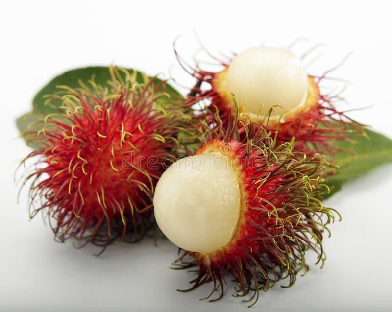 Rambutan. Asian fruit rambutan on the plain background stock photo