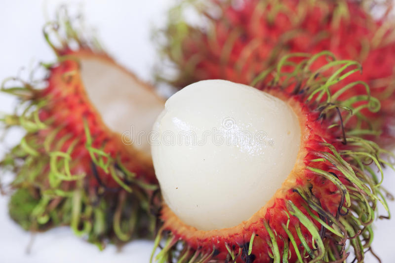 Rambutan da fruta tropical isolado fotos de stock