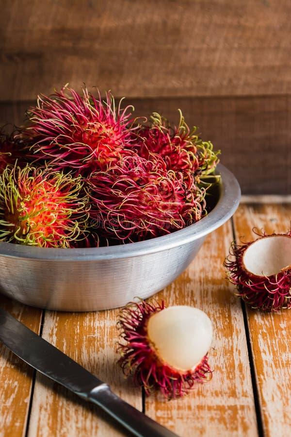 Rambutan. Fresh rambutan on wooden table background royalty free stock photo