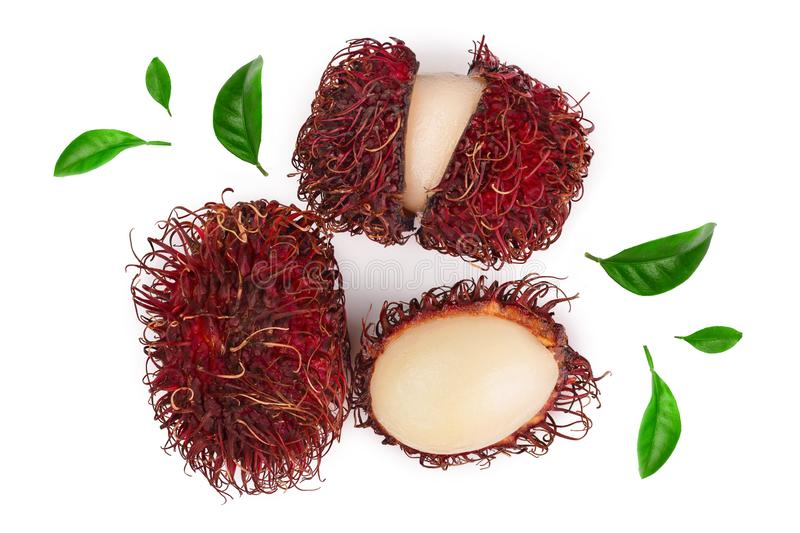 Rambutan with leaves isolated on white background. Tropical fruit. Nephelium lappaceum. Top view. Flat lay stock photos