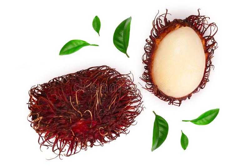 Rambutan with leaves isolated on white background. Tropical fruit. Nephelium lappaceum. Top view. Flat lay royalty free stock photography