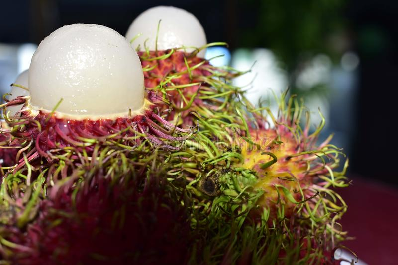 Rambutan is a seasonal fruit. Cooked, red, sweet, delicious stock photo