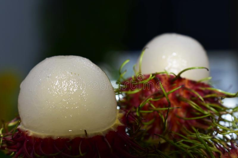 Rambutan is a seasonal fruit. Cooked, red, sweet, delicious stock photography