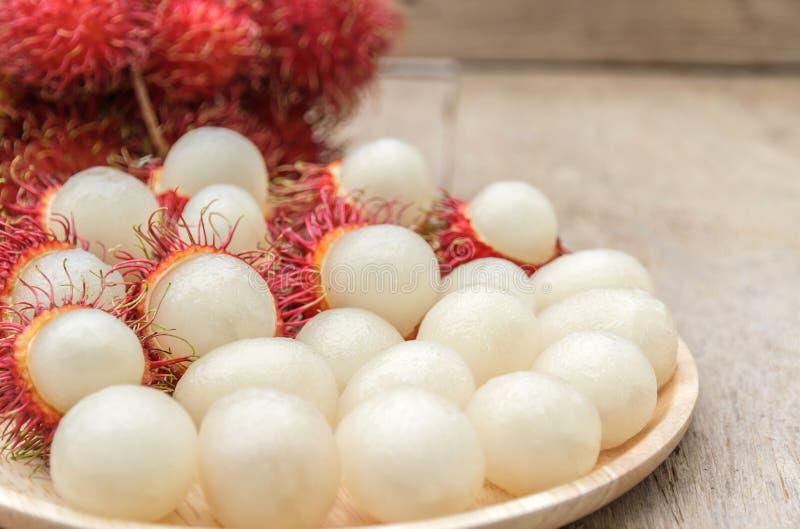Rambutan. In wooden dish on wood table stock photos