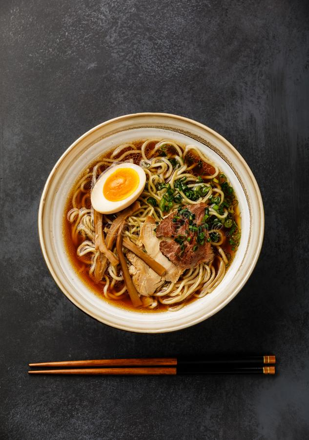 Ramen asian Noodle in broth with Meat and Ajitama pickled Egg in bowl stock photo