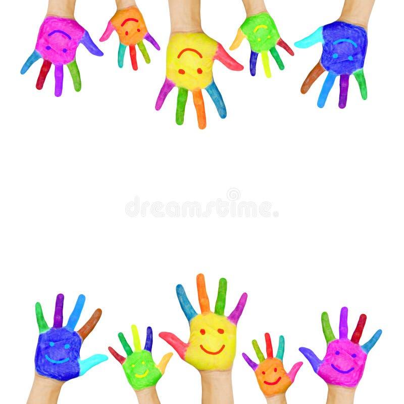 Ramen av färgrika händer som målas med att le, vänder mot.