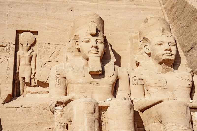 Ramesses the second or Ramesses the Great and Horus statues carved in rock at Abu Simbel Temple. Egyptian civilization history well preserved at one of the royalty free stock photography