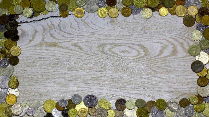 Ramgräns från gamla numismatikmynt för olik värld arkivbilder