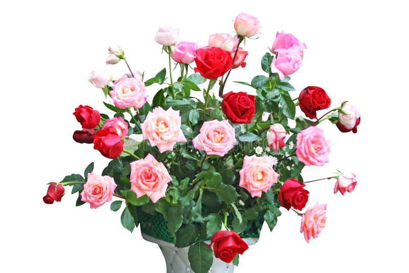 Ramo colorido de rosas en florero foto de archivo
