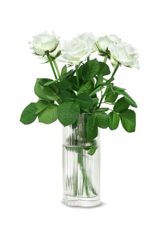 Ramo de las rosas blancas en un florero de cristal imagenes de archivo