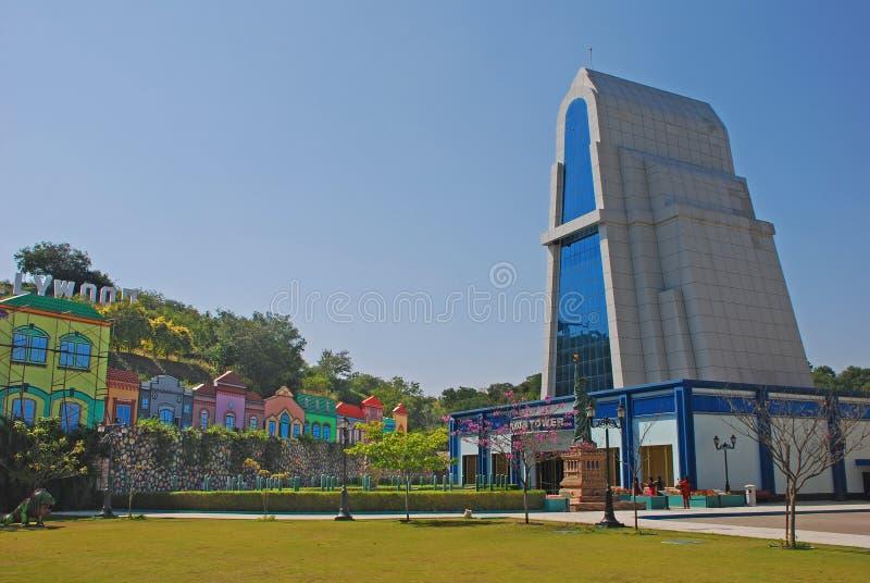 Ramoji Tower at Ramoji Film City. Ramoji Tower with green field and fake colourful building and Hollywood Sign at Ramoji Film City in Hyderabad stock image