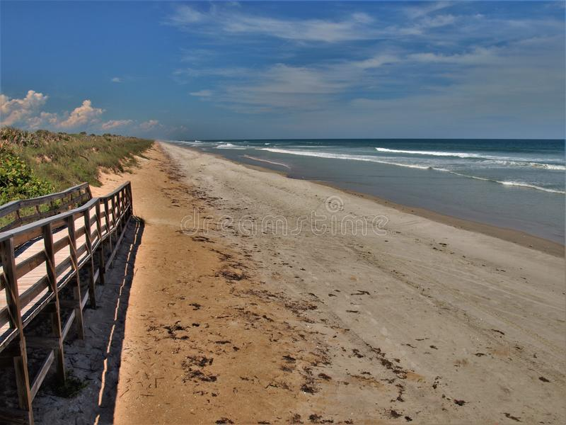 Ramp to the Beach at Canaveral National Seashore. A wooden ramp leads visitors to the surf and sand at Canaveral National Seashore in Florida stock photo