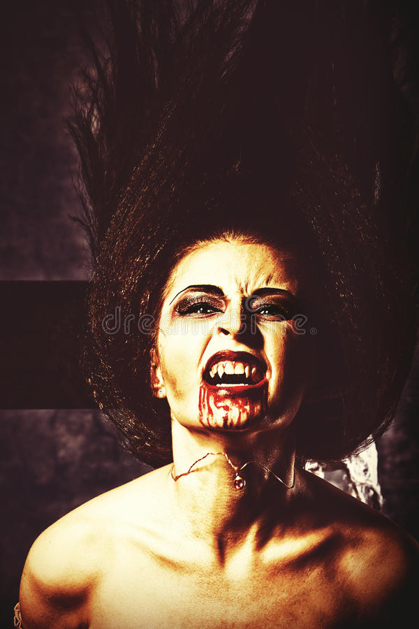 Rampage. Portrait of a bloodthirsty female vampire royalty free stock photos