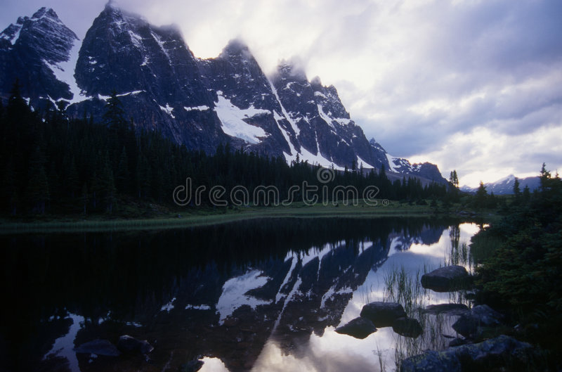 The Ramparts. Bastion, Drawbridge, Dungeon, Redoubt and Paragon are just some of the names given to the peaks of The Ramparts in Jasper National Park, Canada stock image