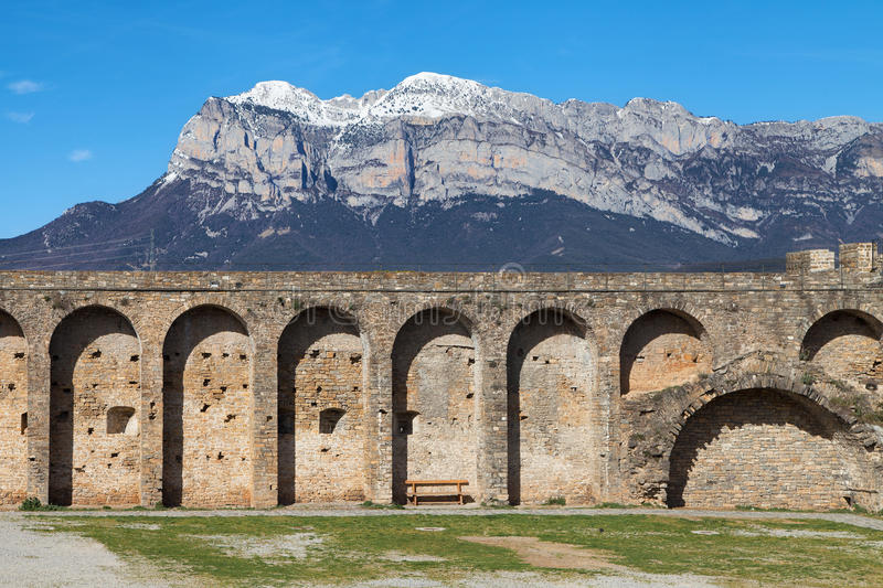 Ramparts of Ainsa. And the Penya Montanyesa mountain in the Aragonese Pyrenees, Spain royalty free stock images