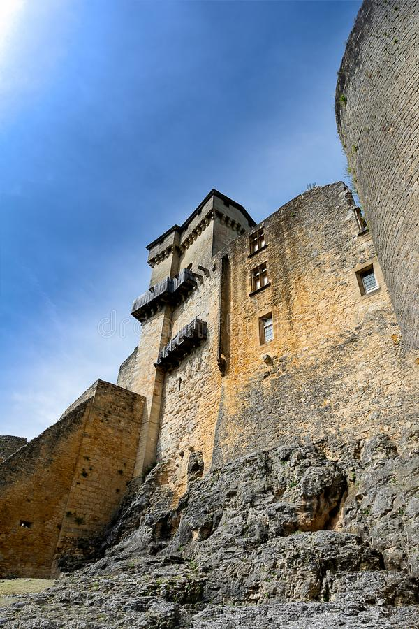 The ramparts of castelnaud castle in the Perigord in France. Seen from below the ramparts of the castle of Castelnaud with a sheer wall and fortified works, one stock photography